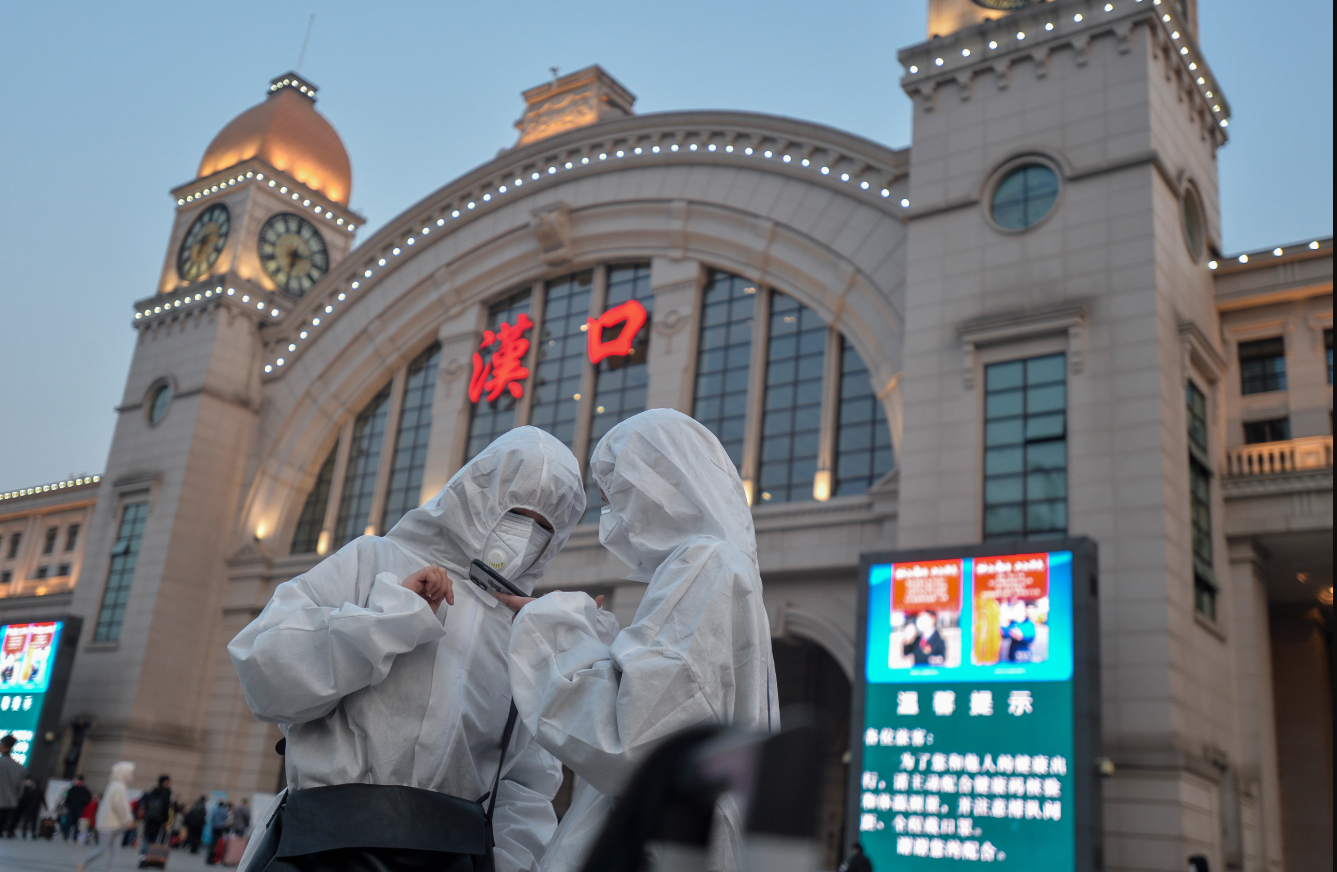 Two people outside the Hankou Railway Station in Wuhan on Wednesday, after the lockdown was apparently lifted. Credit: Barcroft Media/Getty
