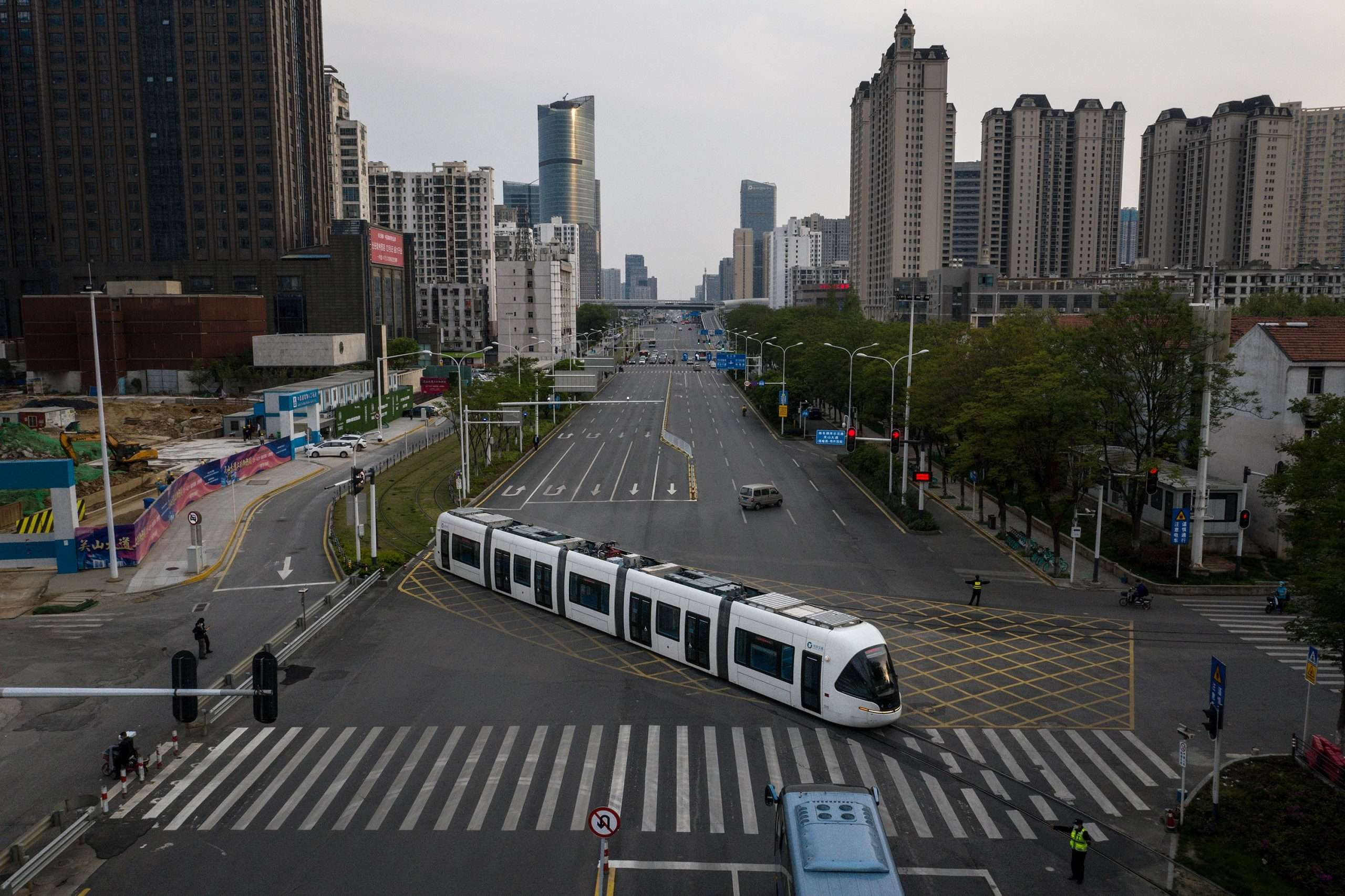 A drone view showing a Wuhan tram working again on Wednesday, but not many commuters. Credit: Getty