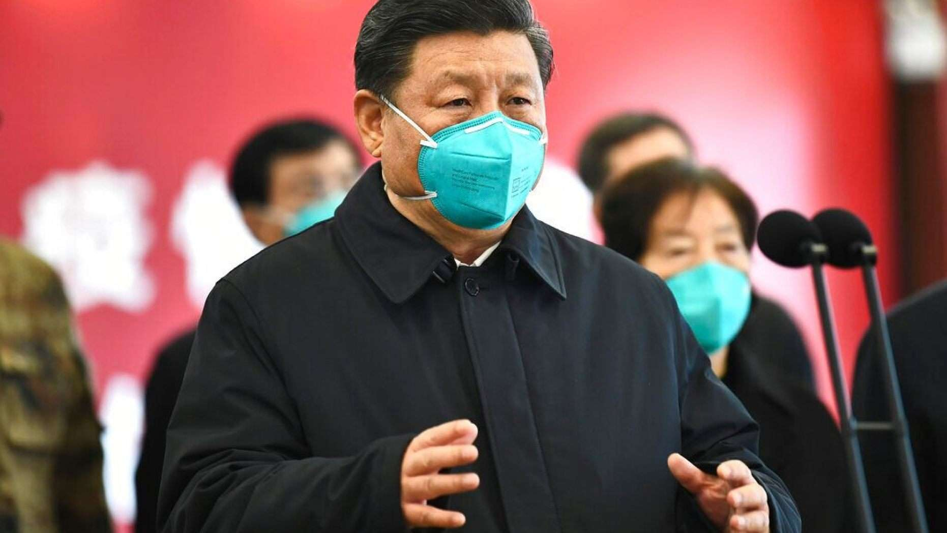 In this Tuesday, March 10, 2020, photo released by China's Xinhua News Agency, Chinese President Xi Jinping talks by video with patients and medical workers at the Huoshenshan Hospital in Wuhan in central China's Hubei Province. (Xie Huanchi/Xinhua via AP)