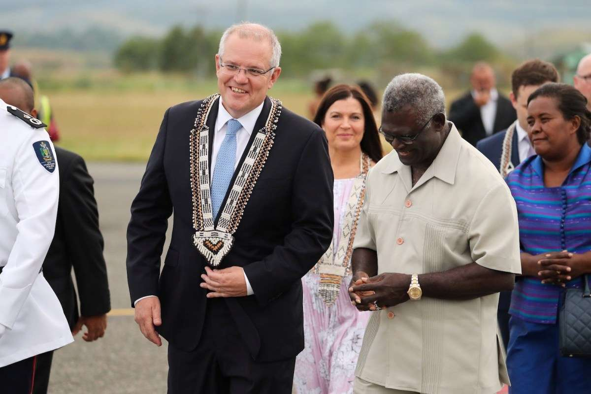 Australian Prime Minister Scott Morrison is greeted by Solomon Islands' PM Manasseh Sogavare, right, during his trip to Honiara on June 2. Australia is the largest donor in the region.