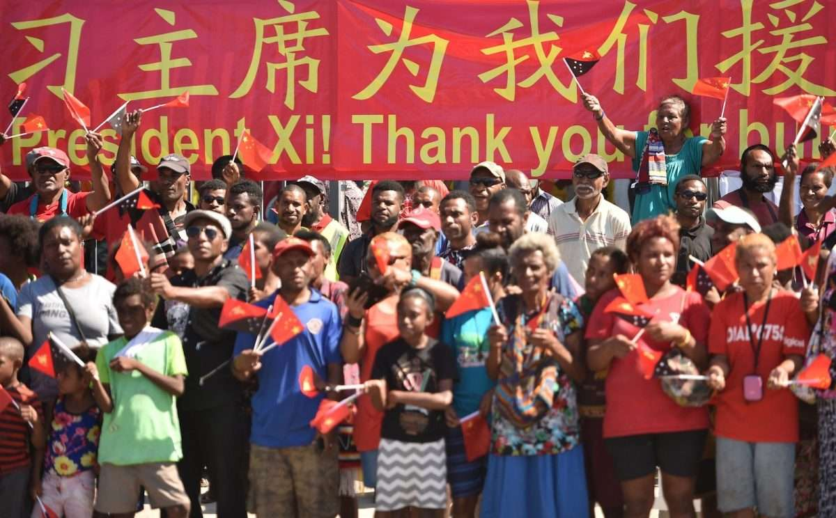 Papuans welcome China's President Xi Jinping at the Butuka school in Port Moresby ahead of the APEC summit in November last year. Photo: Peter Parks / AFP