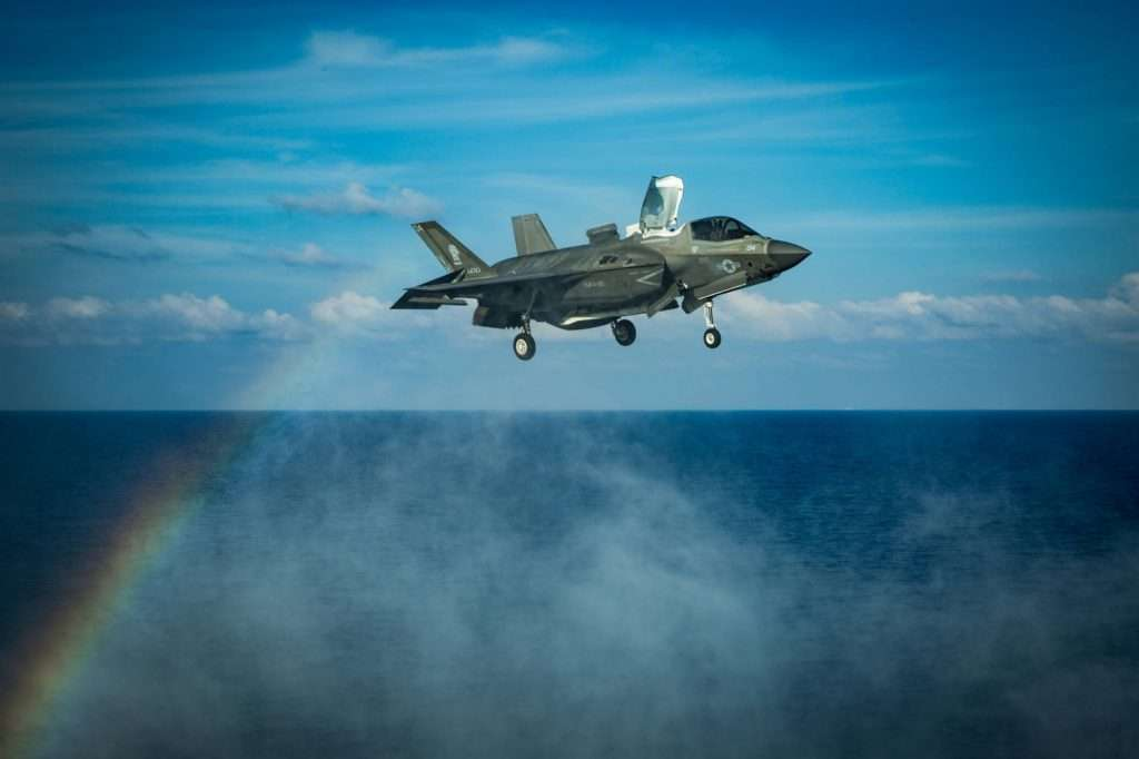 A U.S. Marines F-35B fighter jet prepares to land on the flight deck of the amphibious assault ship USS America during flight operations in the South China Sea on April 18.