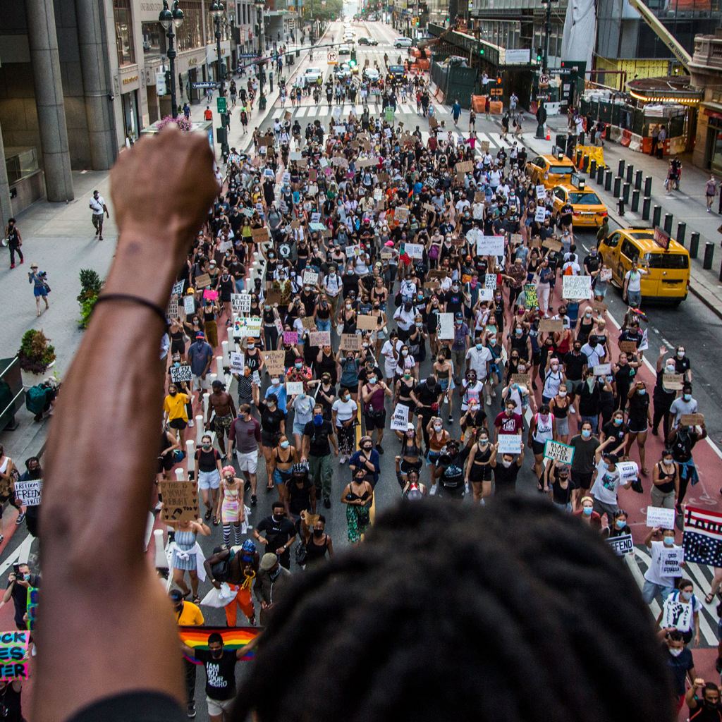 "NEW YORK, NY - JULY 26: A man raises his arm in support of the crowd of protesters marching in downtown New York, NY on July 26, 2020. Hundreds of New York activists participated in a march to condemn what they see as excessive focus by federal authorities in Portland, Oregon and continue to support the different movements of ""Black Lives Matter"". (Photo by Pablo Monsalve/VIEWpress via Getty Images)"