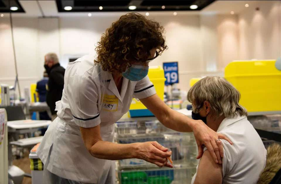 A woman receiving a vaccination this week at Villa Park, in Birmingham Credit: AFP
